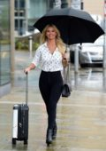 Christine McGuinness smiles for the camera as she arrives at the ITV Studio's in Media City, Manchester, UK
