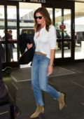 Cindy Crawford keeps it classic in a white shirt and blue jeans as she arrives at LAX airport in Los Angeles