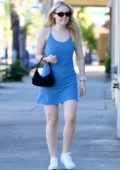 Dakota Fanning seen wearing a blue dress as she arrives for her nail appointment in Studio City, California