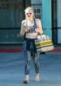 Dakota Fanning wears a patterned crop top with matching leggings as she leaves after an workout session in Los Angeles