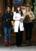 Dakota Johnson looks amazing in a white coat while enjoying a girls night out in Los Feliz, California