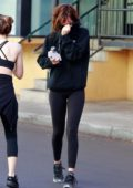 Dakota Johnson looks exhausted after a workout session as she tries to avoid the cameras while leaving the gym in Studio City, California