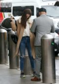 Dakota Johnson spotted in a beige fur-lined coat as she arrives to fly out of LAX airport in Los Angeles