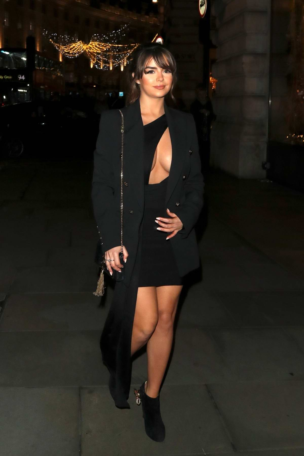 Demi Rose stuns in a black outfit during a night out at Cafe Royal in London, UK
