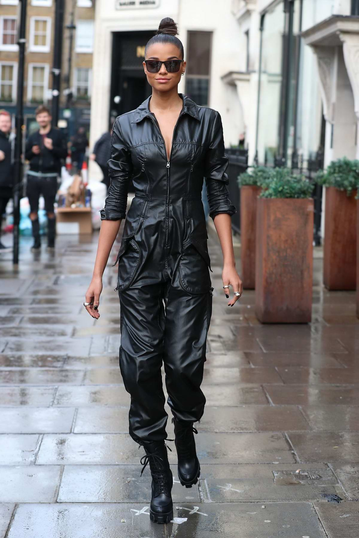 Ella Balinska looks stylish in a black leather jumpsuit as she visits KISS FM radio studios in London, UK
