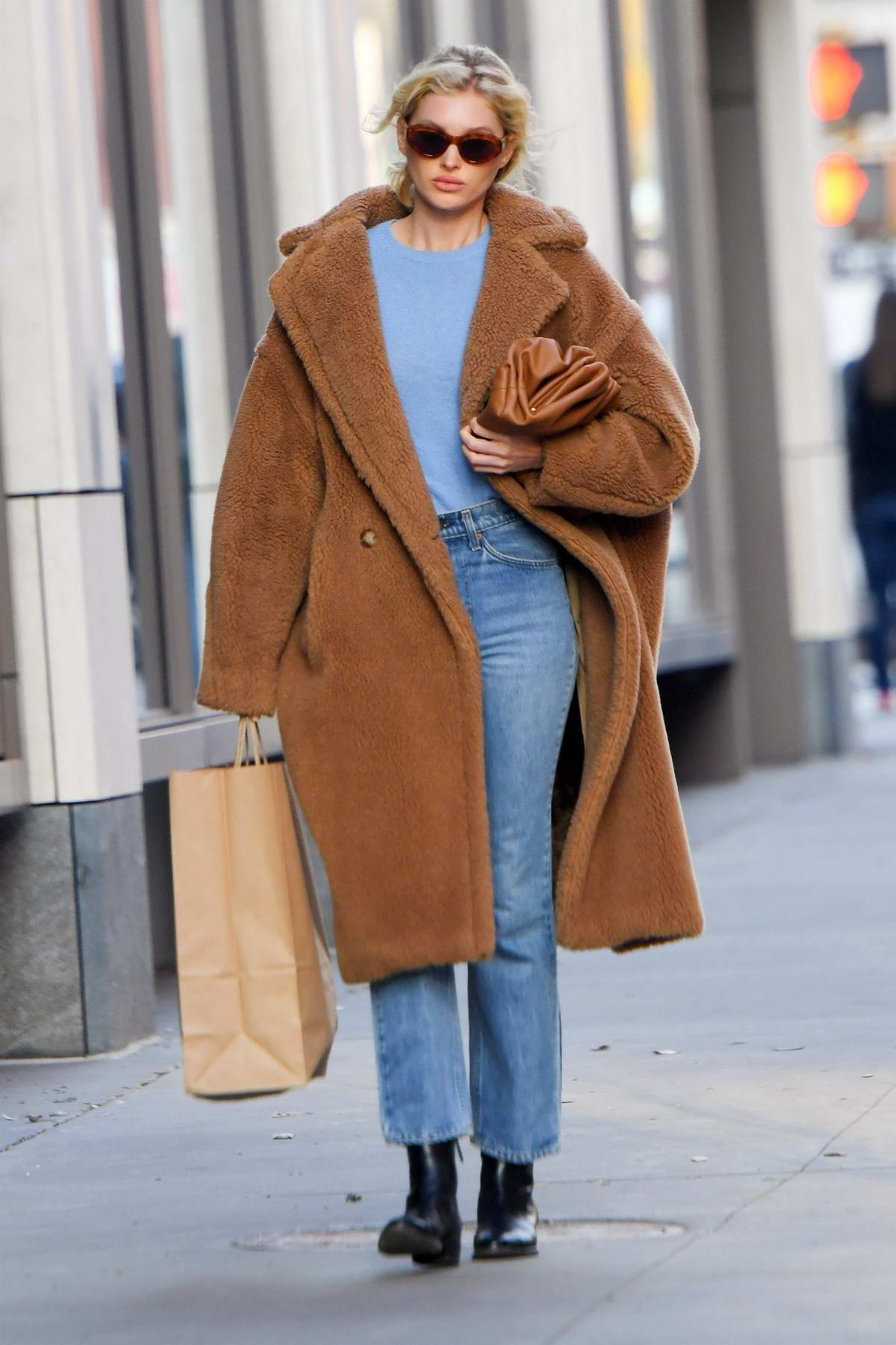 Elsa Hosk looks cozy in a brown teddy coat as steps out for a stroll through New York