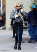 Elsa Hosk looks stylish in a Dior jacket with patterned sweater and leggings while out for a healthy drink in New York City