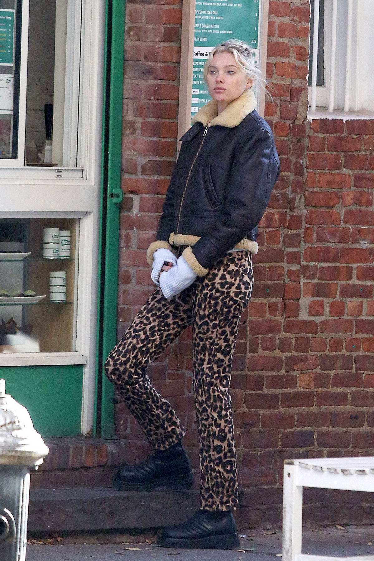 Elsa Hosk wears a fur-lined jacket and animal print pants while making a Matcha run in New York City