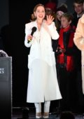 Emilia Clarke attends the Christmas Lights switch on & Sing Along at Covent Garden in London, UK