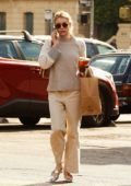 Emma Roberts looks casual in all beige as she grabs coffee in Los Angeles