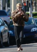 Emma Roberts steps out for coffee wearing a leopard print fur jacket in Los Angeles