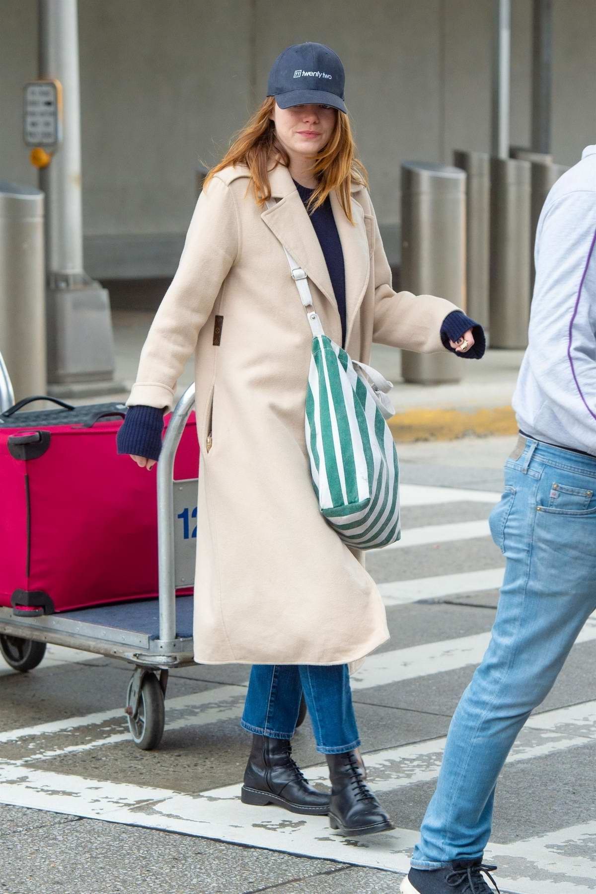 Emma Stone seen arriving at JFK Airport sporting a cozy yet stylish look in New York City