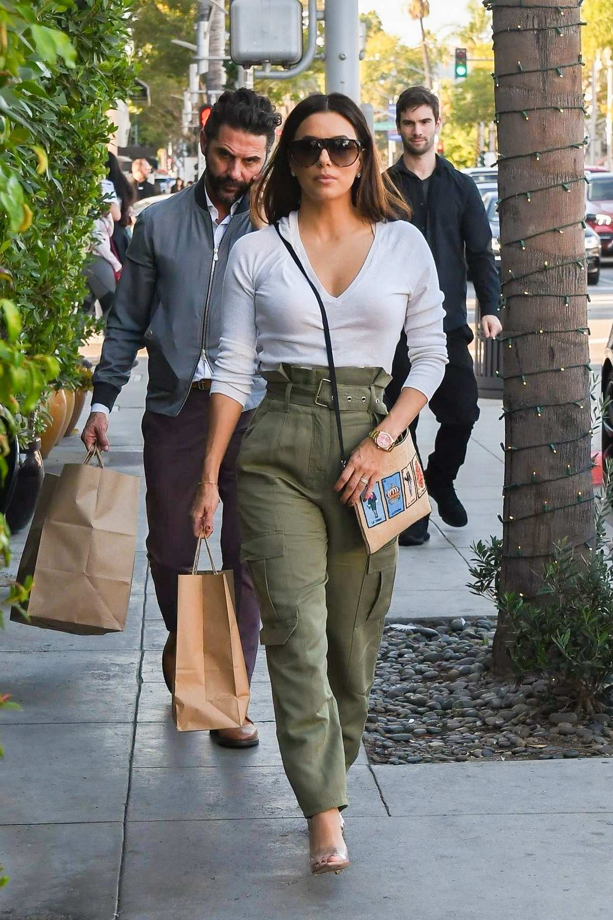 Eva Longoria looks great in white top and green pants while out shopping with husband José Bastón in Beverly Hills, Los Angeles