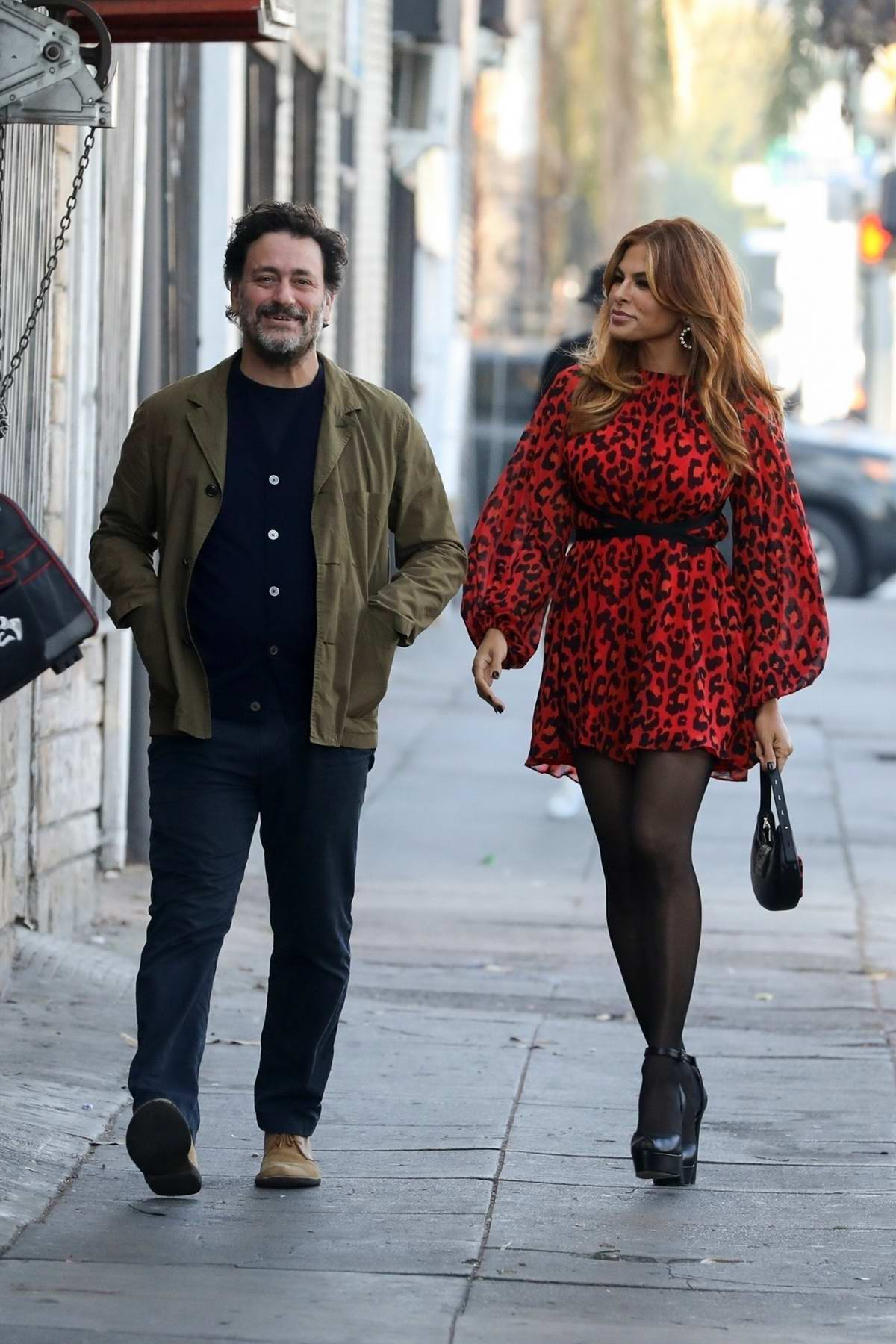 Eva Mendes looks great as she steps out for dinner with a friend in Los Angeles