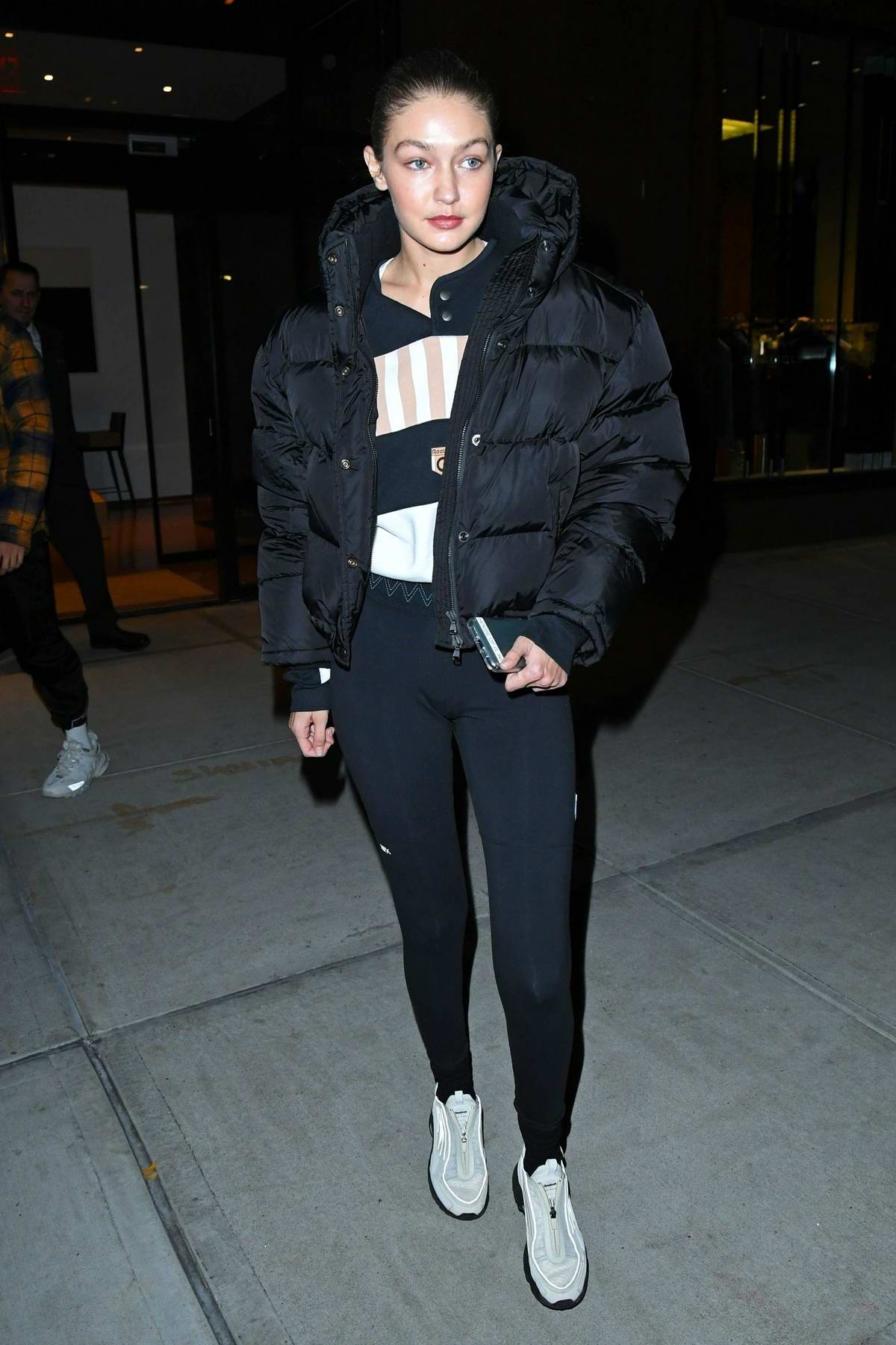 Gigi Hadid sports her new Reebok x Gigi Hadid Capsule Collection while heading out for dinner with friends in New York City