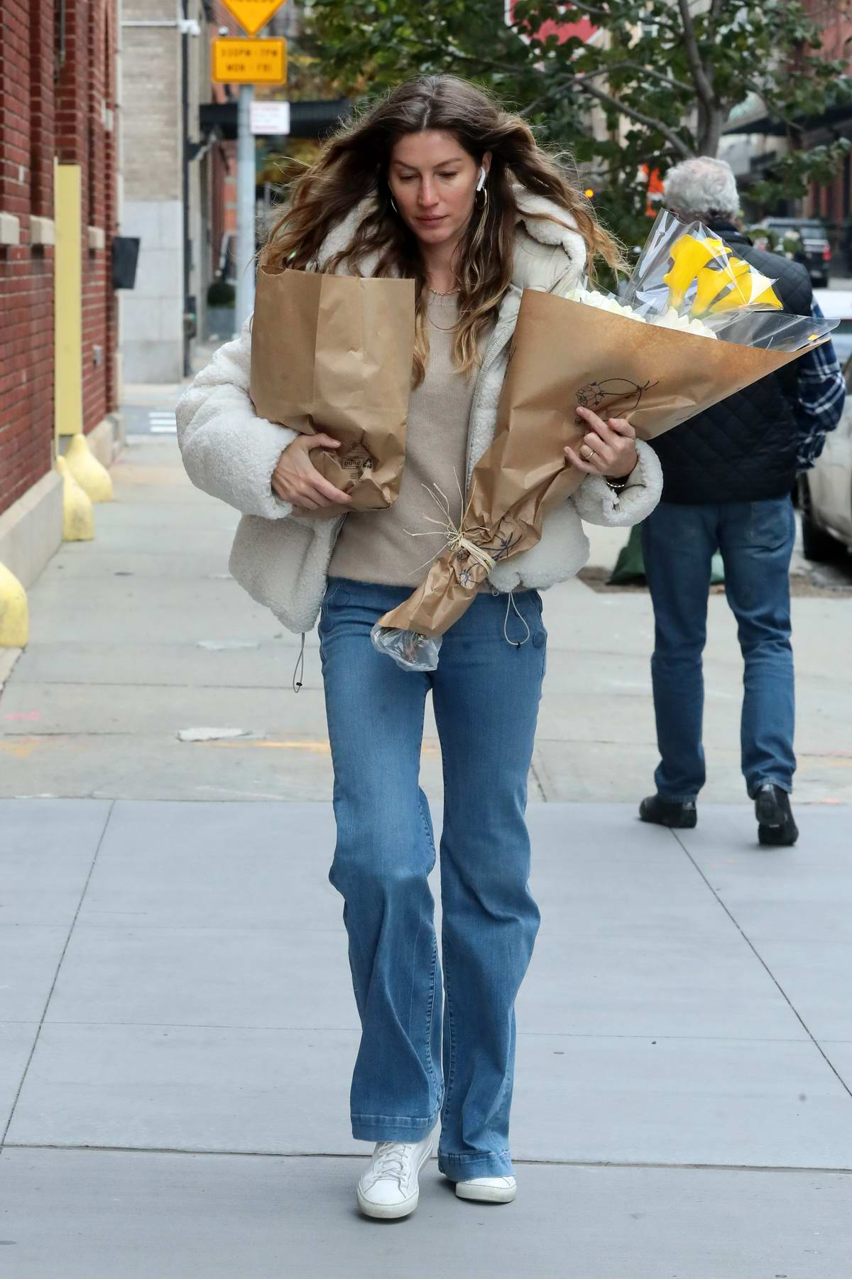 Gisele Bundchen picks up some flowers while out in New York City