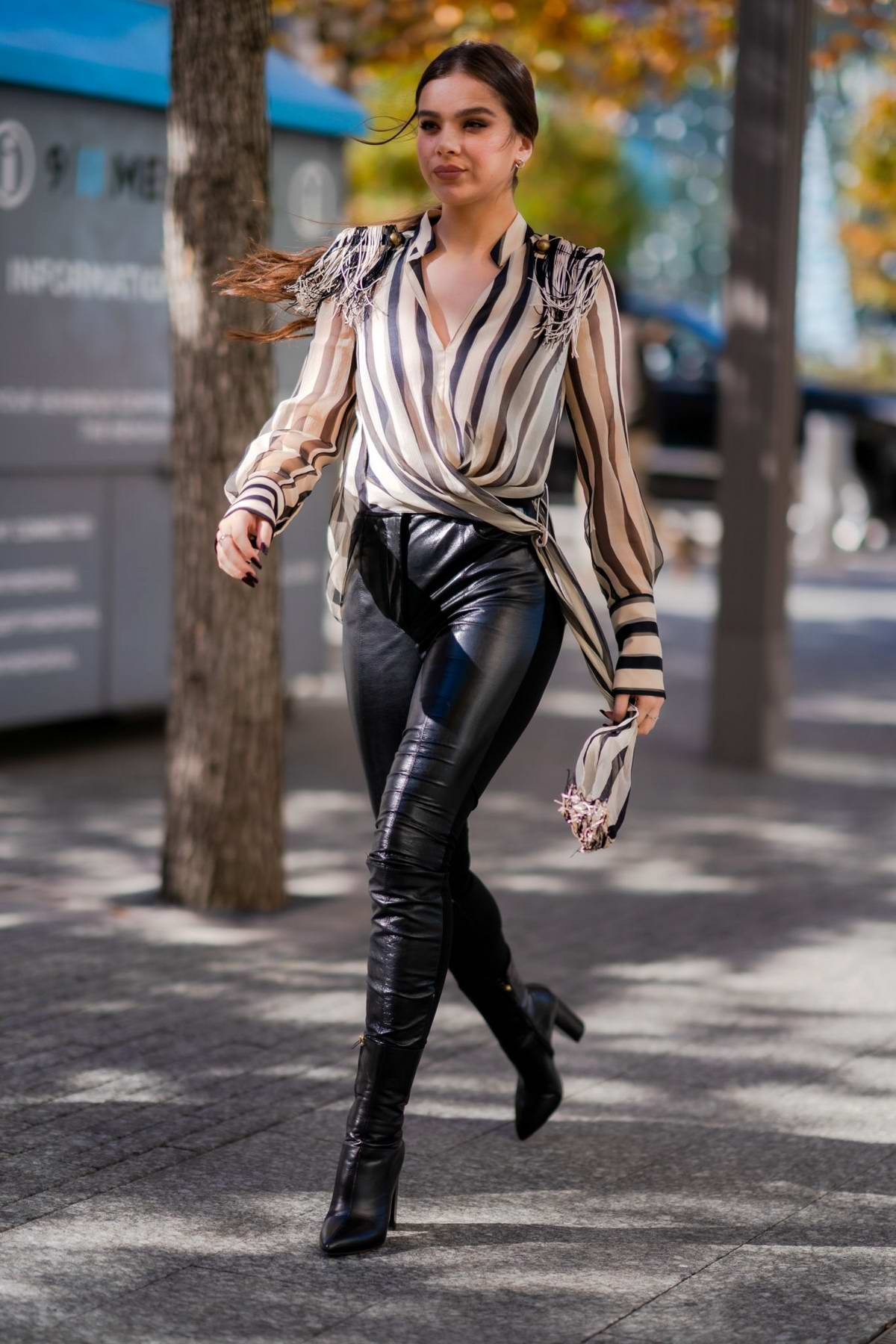 Hailee Steinfeld looks stylish in a striped wrap shirt paired with black leather pants as she steps out in Tribeca, New York City