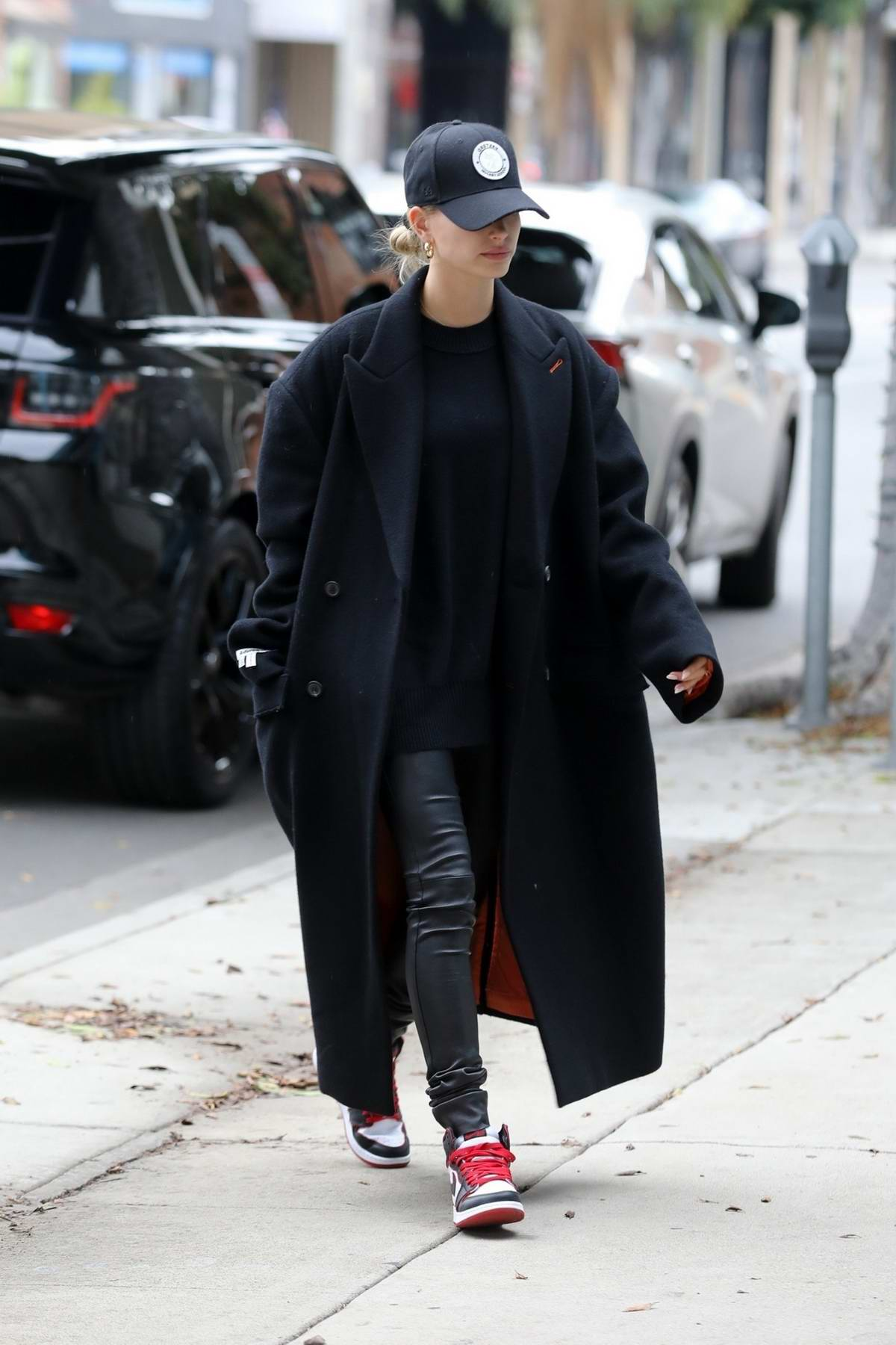 Hailey Bieber dons all black while visiting a hair salon in Los Angeles