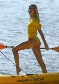 Hailey Bieber sports a yellow swimsuit during a beach photoshoot at Key Biscayne in Miami, Florida