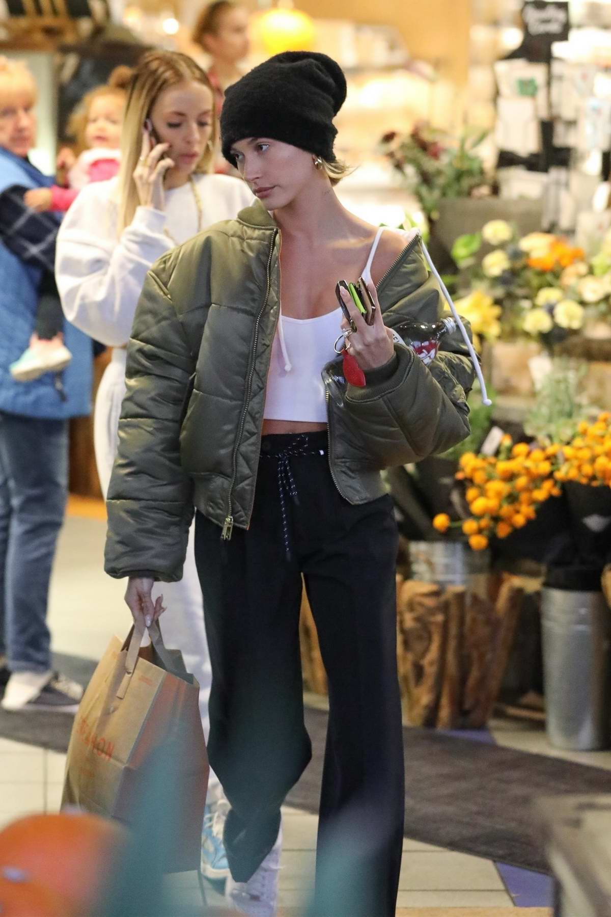 Hailey Bieber stops by to pick some groceries at Erewhon market in Los Angeles