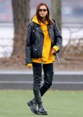 Irina Shayk looks stylish in black leather jacket paired with a yellow hoodie and thigh high boots during a shoot in New York City