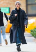 Jaimie Alexander wears a long coat with a scarf and beanie while out for stroll in New York City