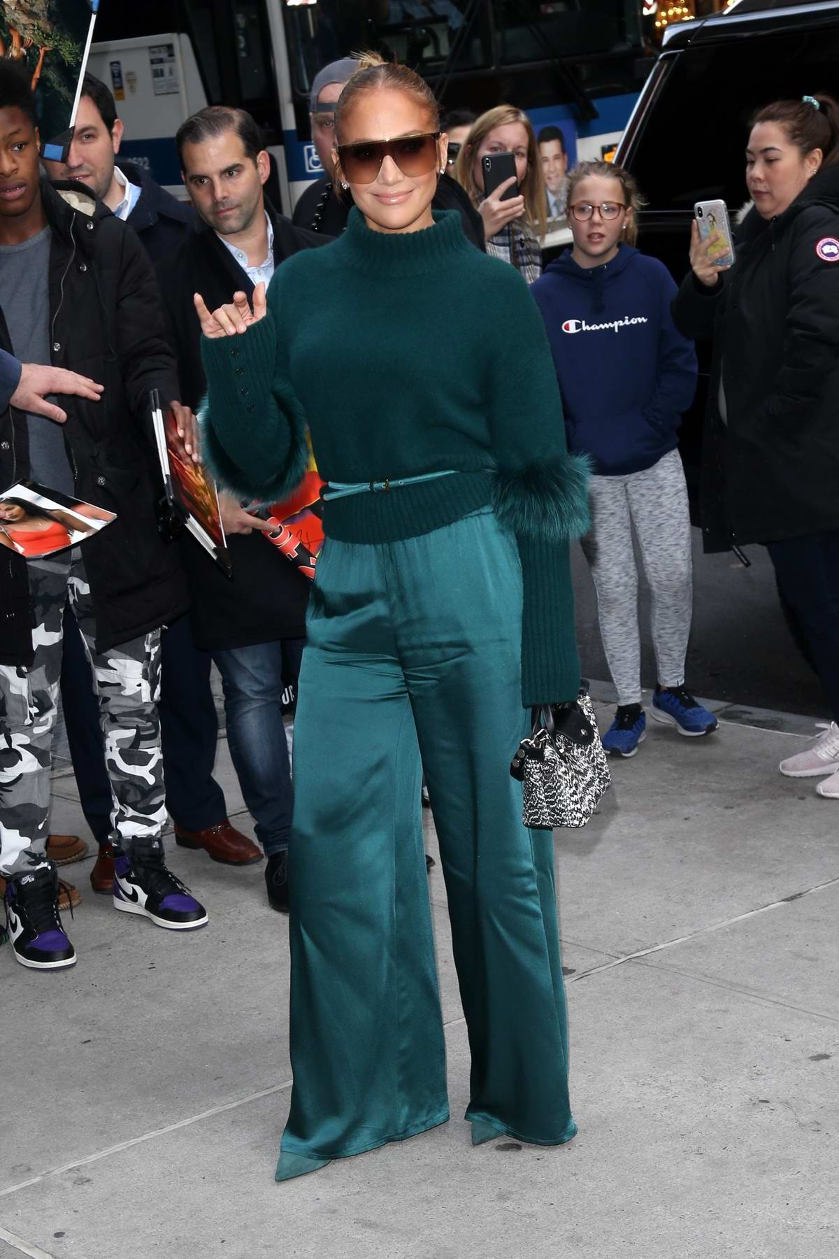 Jennifer Lopez looks great in green outside of the DGA Theater in New York City