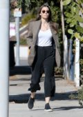 Jessica Biel seen wearing a houndstooth blazer over a white top as she steps out in Los Angeles