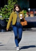 Joey King spotted in a green jacket, striped tee, and jeans while out on a coffee run in Los Angeles