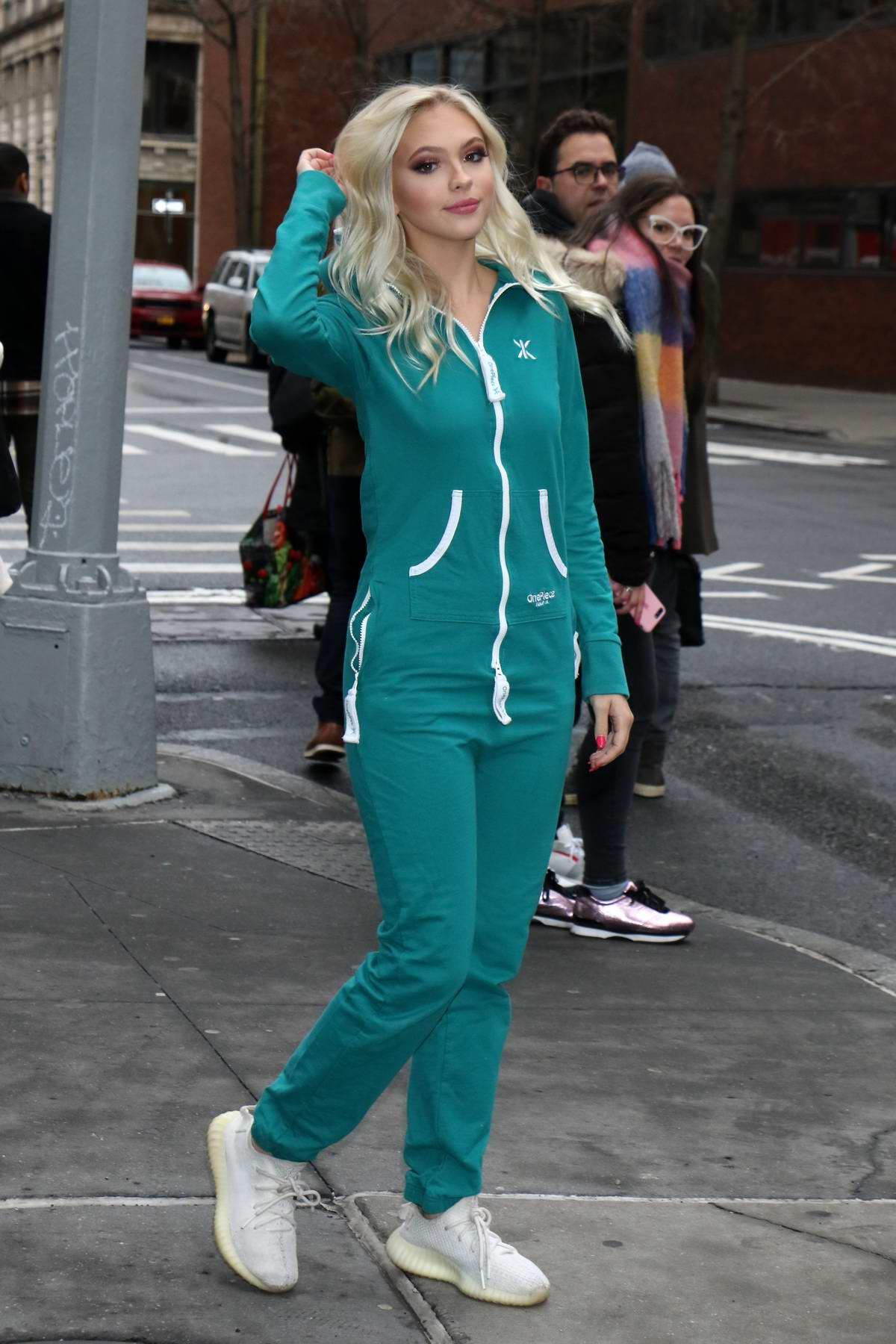 Jordyn Jones looks cute in a teal onesie as she leaves Build Series in New York City