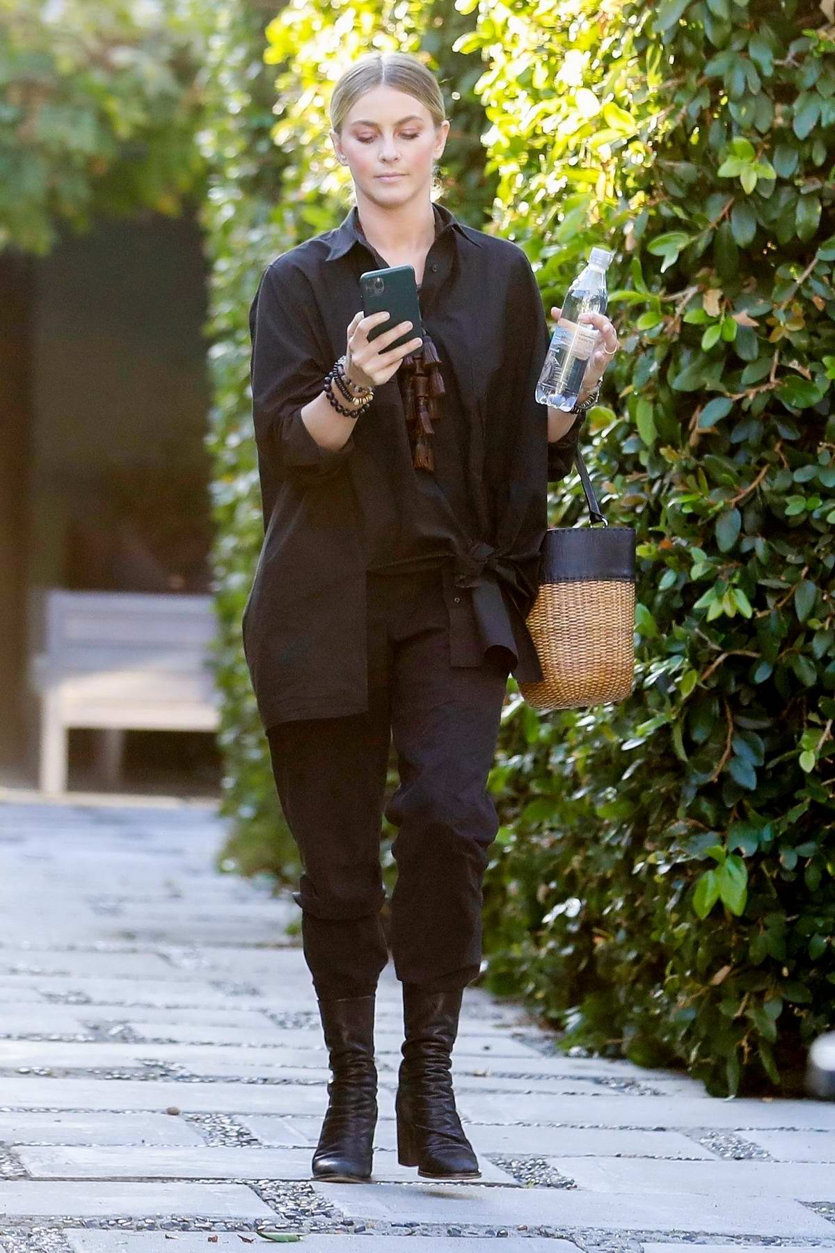 Julianne Hough checks her messages as she leaves her office in West Hollywood, Los Angeles