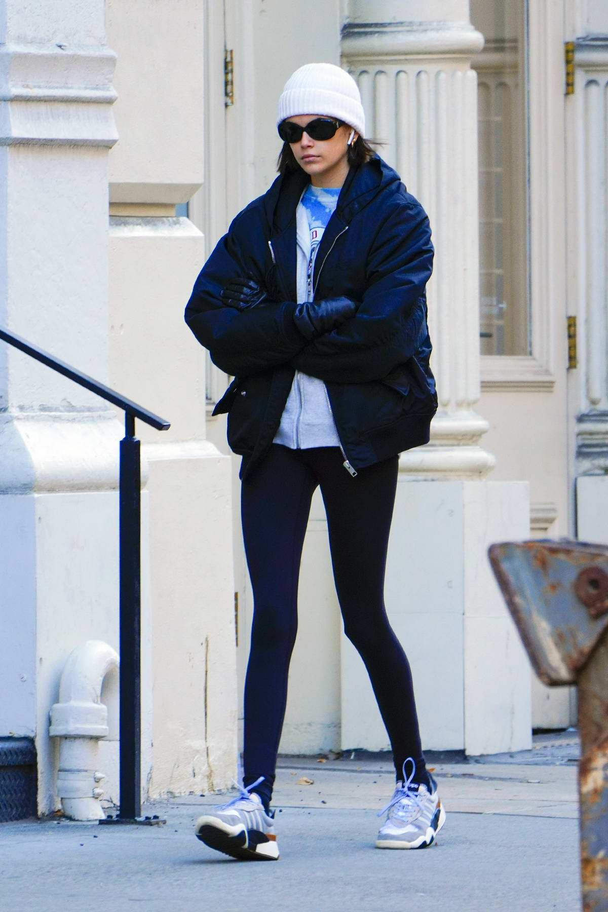 Kaia Gerber sports a white beanie with a jacket and leggings as she heads to the gym in New York City