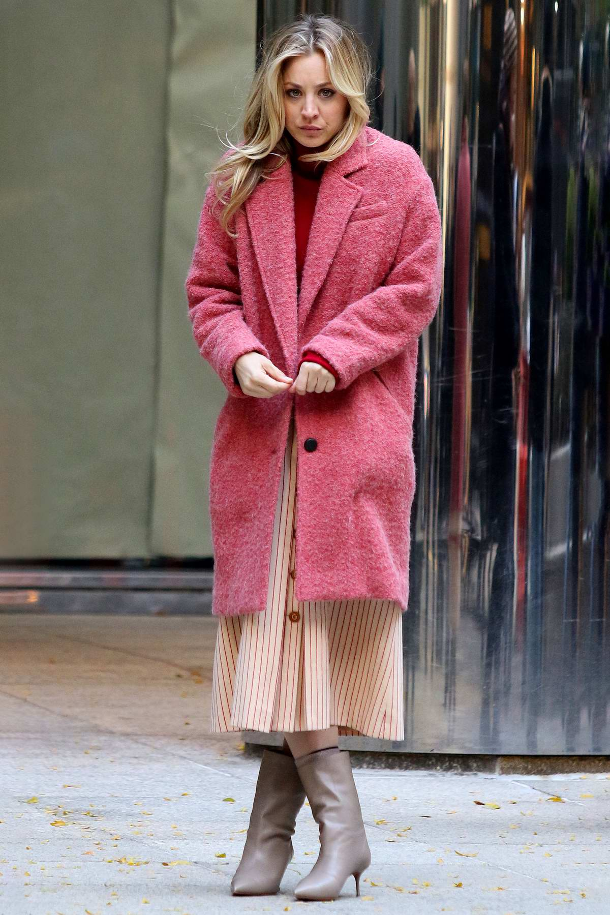 Kaley Cuoco seen wearing a pink coat on the set of 'The Flight Attendant' while filming an emotional scene in New York City