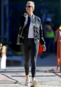 Karlie Kloss looks stylish in a black jacket paired with a white top and black leggings as she steps out in New York City