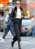 Karlie Kloss looks stylish in black leather jacket paired with a white turtleneck as she steps out in New York City
