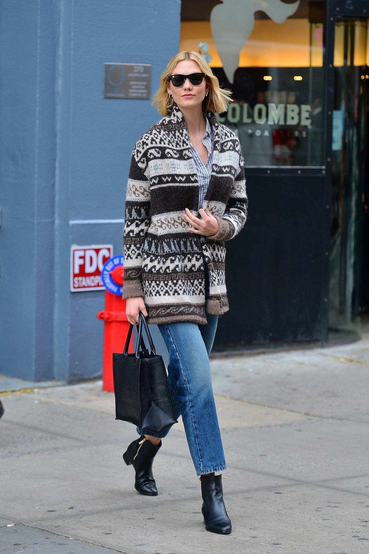 Karlie Kloss shares a smile on her way to a local eatery in New York City