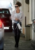 Kate Beckinsale wears a white see-through windbreaker over a sports bra as she steps out in Los Angeles