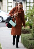 Katherine Schwarzenegger is all smiles as she leaves a Leclaireur store wearing a fuzzy brown coat in Los Angeles