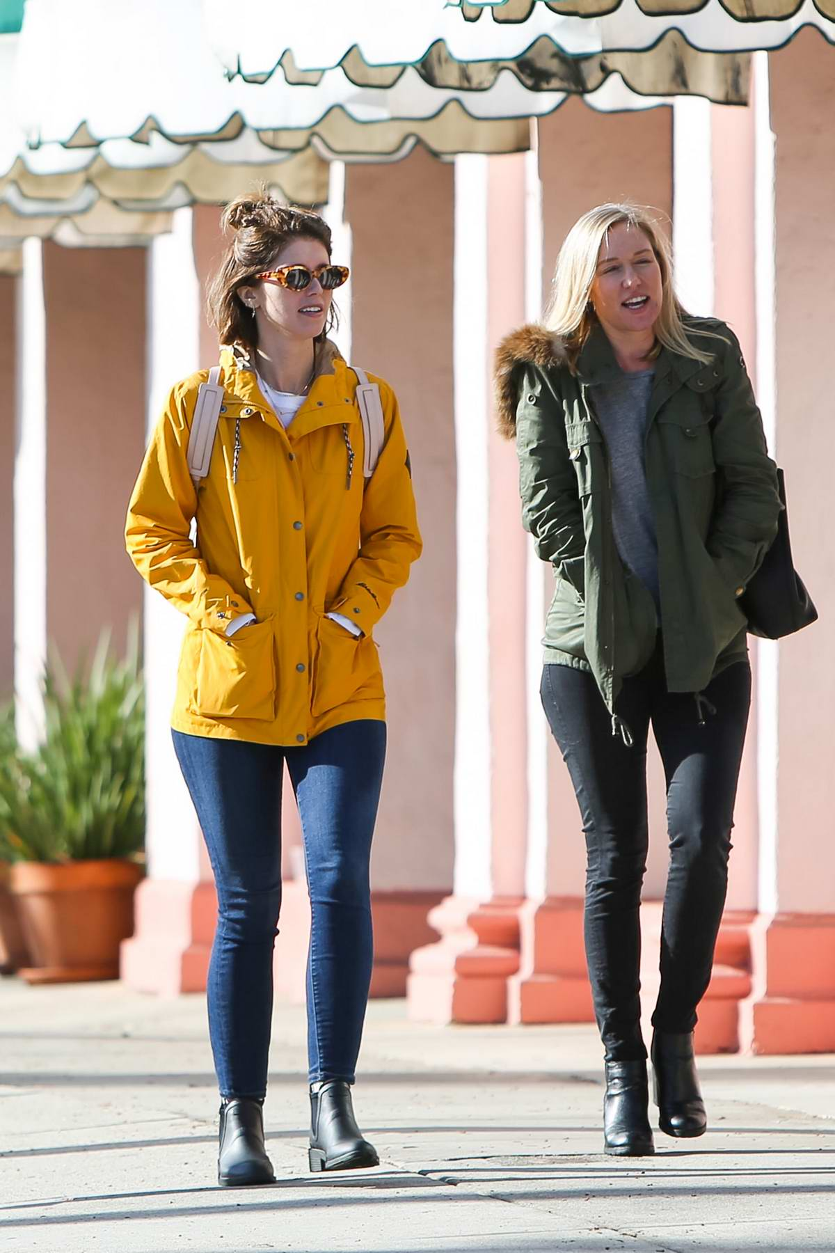 Katherine Schwarzenegger stands out in a bright yellow jacket as she enjoys a stroll with a friend in Los Angeles