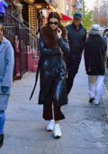 Kendall Jenner goes casual in a fur collared leather jacket and white sneakers for lunch with friends in New York City