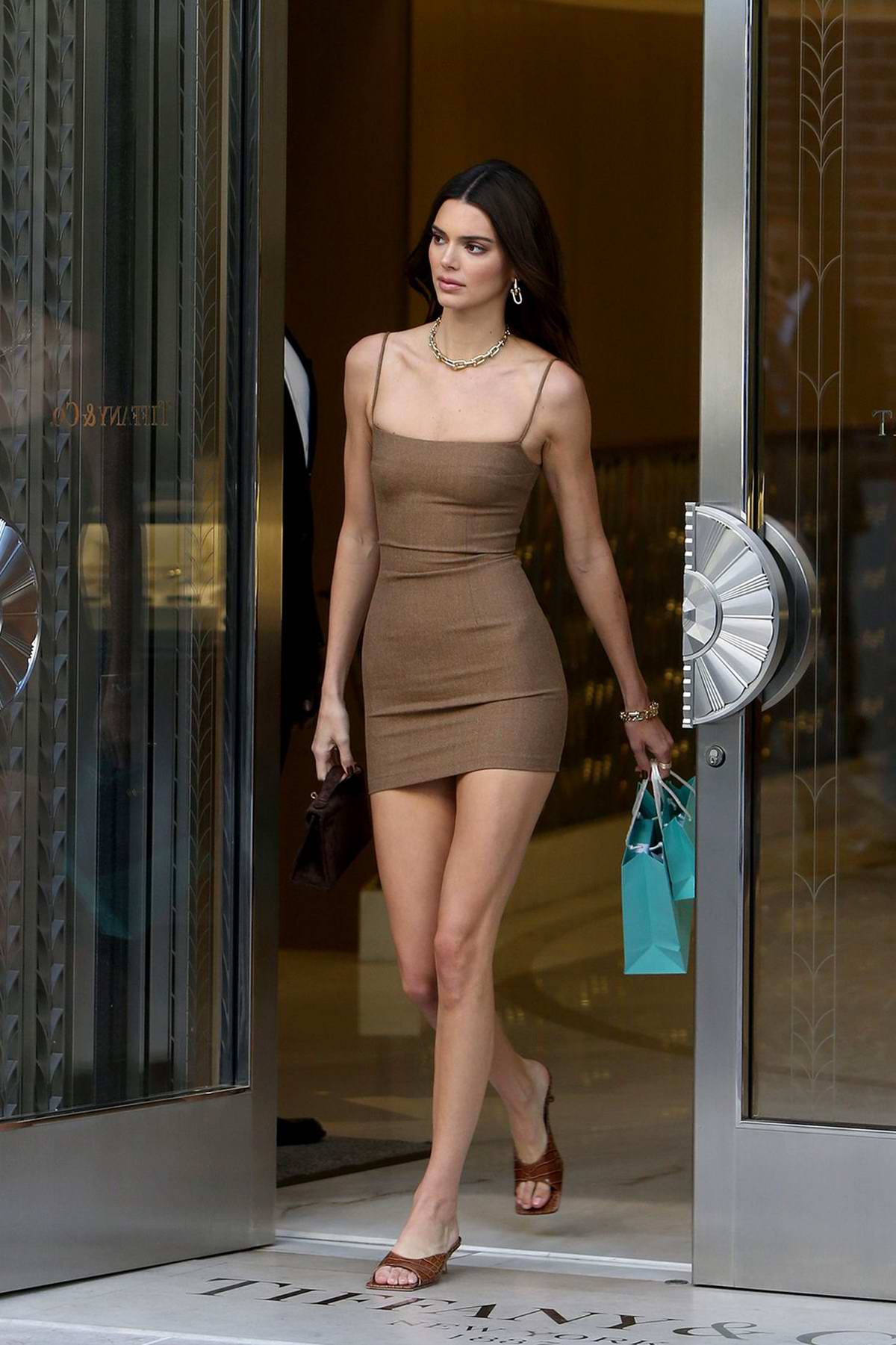 Kendall Jenner stuns in a brown mini dress while shopping at Tiffany & Co on Rodeo Drive in Beverly Hills, Los Angeles