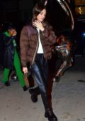 Kendall Jenner rocks brown puffer jacket and black leather pants as she arrives for dinner at Cipriani in New York City