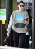Kendall Jenner sports a green sweatshirt and black leggings while stopping by for a beet juice at Earthbar in Beverly Hills, Los Angeles