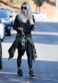 Khloe Kardashian keeps things casual in black activewear while visiting a friend in Van Nuys, California