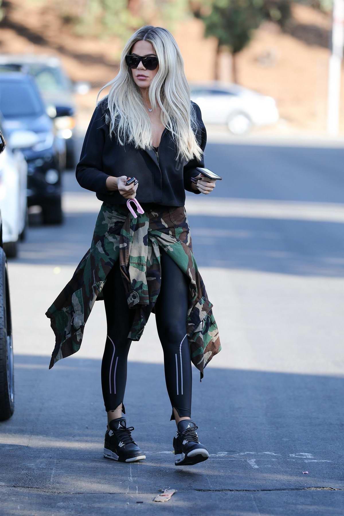 Khloe Kardashian keeps things casual in black activewear while visiting a friend in Van Nuys, California