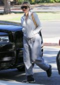 Khloe Kardashian sports a grey hoodie with matching sweatpants as she steps out in Calabasas, California