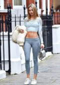 Kimberley Garner flaunts her incredible figure in a crop top and leggings as she leaves the gym in Chelsea, London, UK