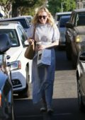 Kirsten Dunst dons all white while picking up coffee and snacks from Joan's on Third in Studio City, Los Angeles