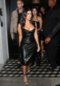 Kourtney Kardashian wears plunging black dress during a girls night out at Craig's in West Hollywood, Los Angeles