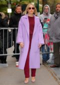 Kristen Bell poses in a red velvet outfit with lavender coat while out promoting 'Frozen 2' in New York City